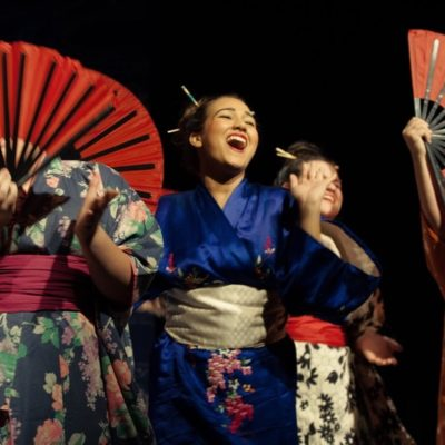 Actors sing in The Mikado
